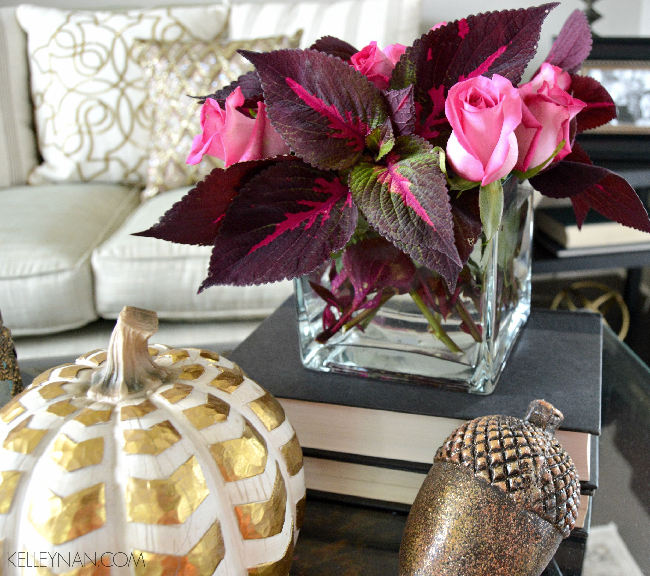 Red coleus and pink roses in formal living room with gold fall accessories