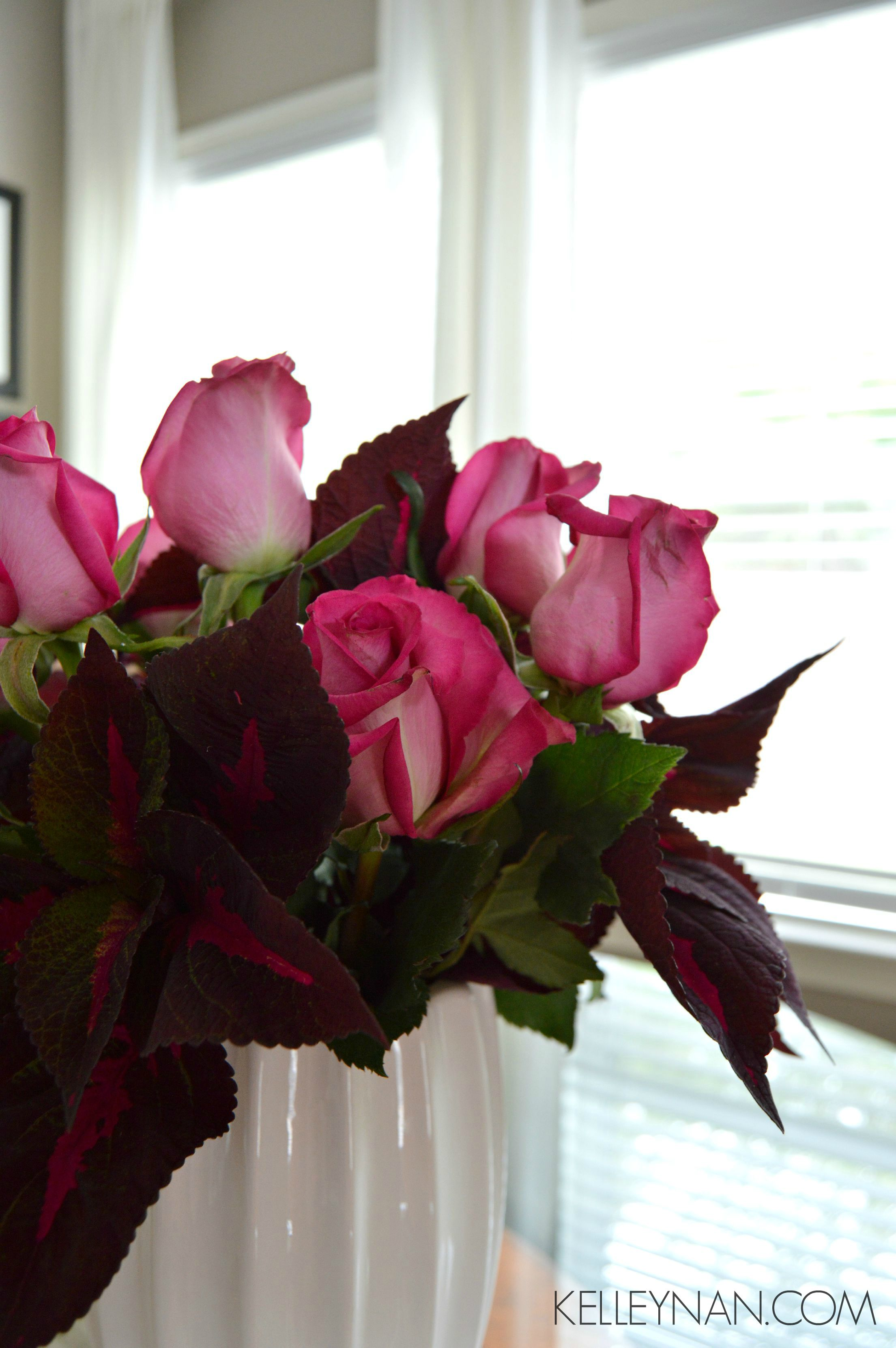 Red coleus and pink roses in the breakfast nook