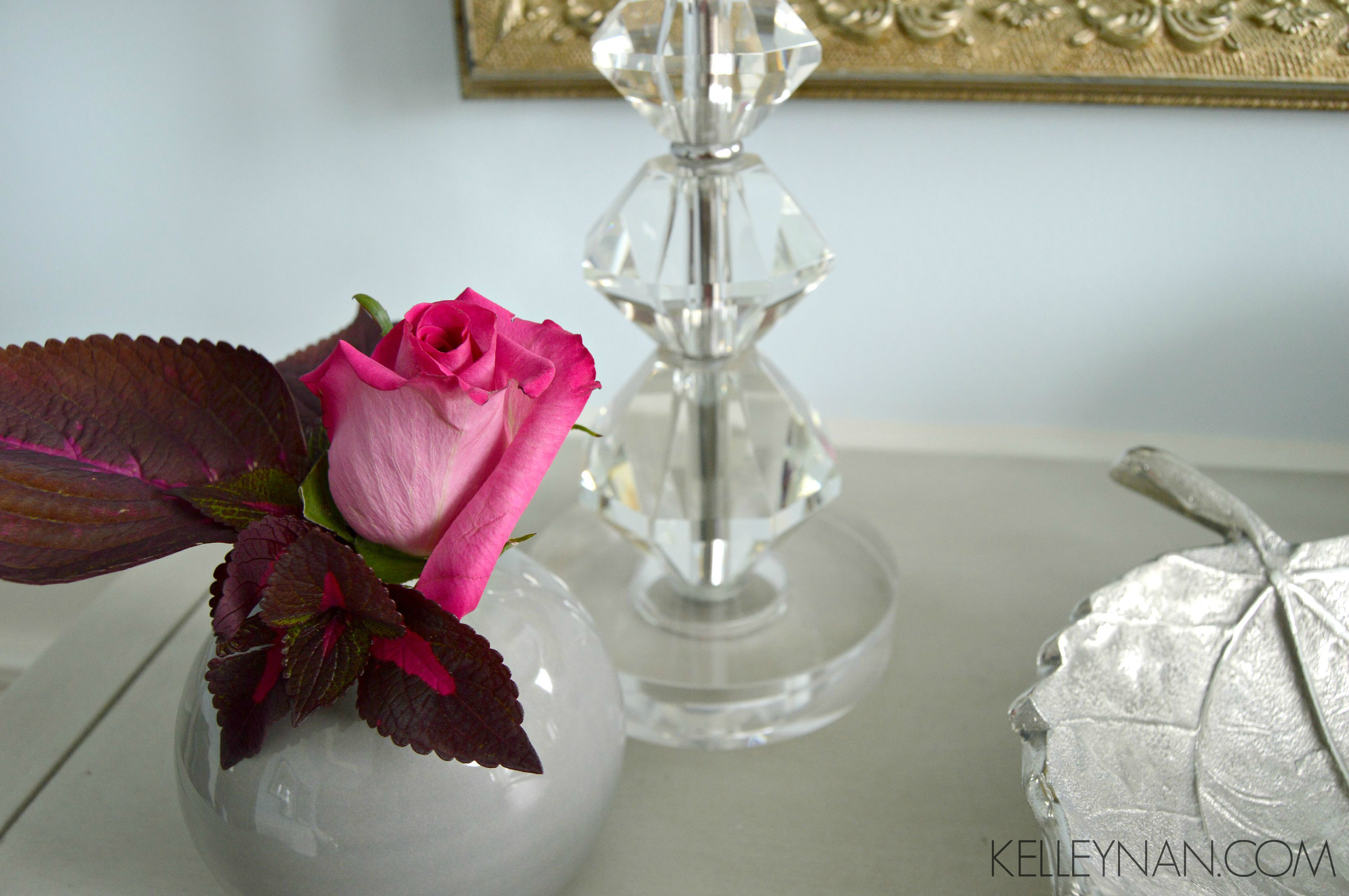 Red coleus and pink rose bud in the formal dining room