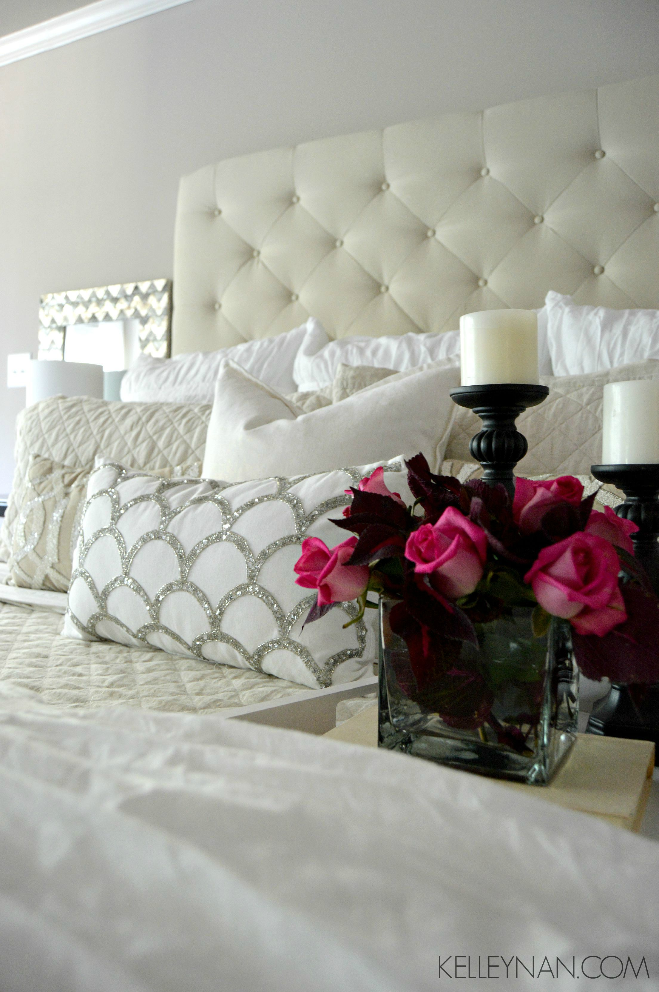 Red coleus and pink roses in white and neutral master bedroom