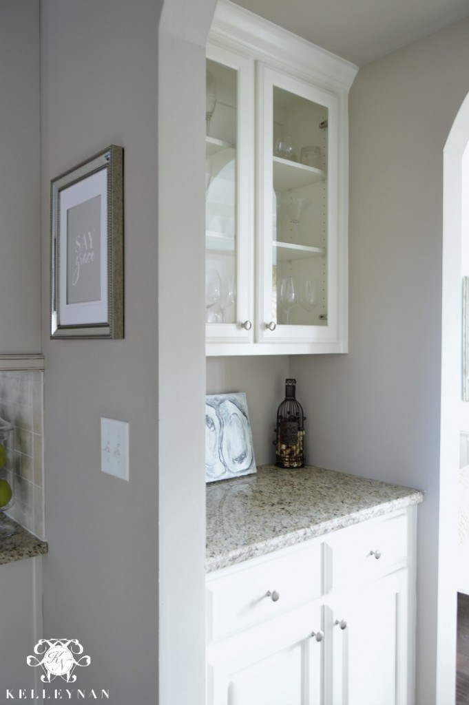 butler's pantery with glass doors and granite counter top
