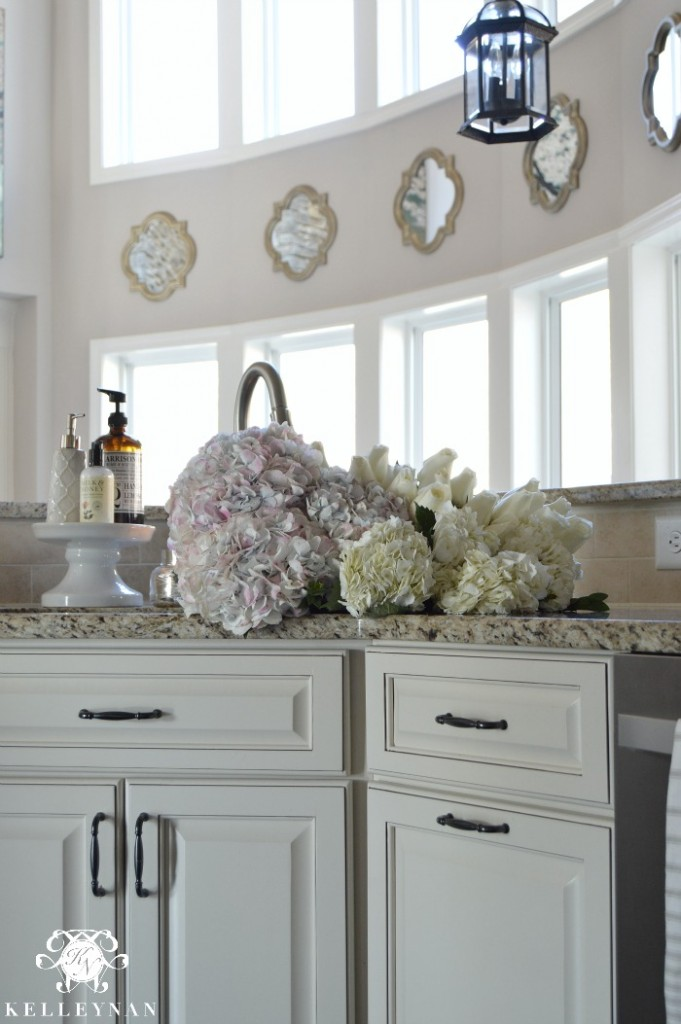 Flowers and Hydrangeas in Sink in Neutral Kitchen