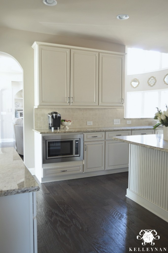 Microwave Low in White Kitchen Dark Floors