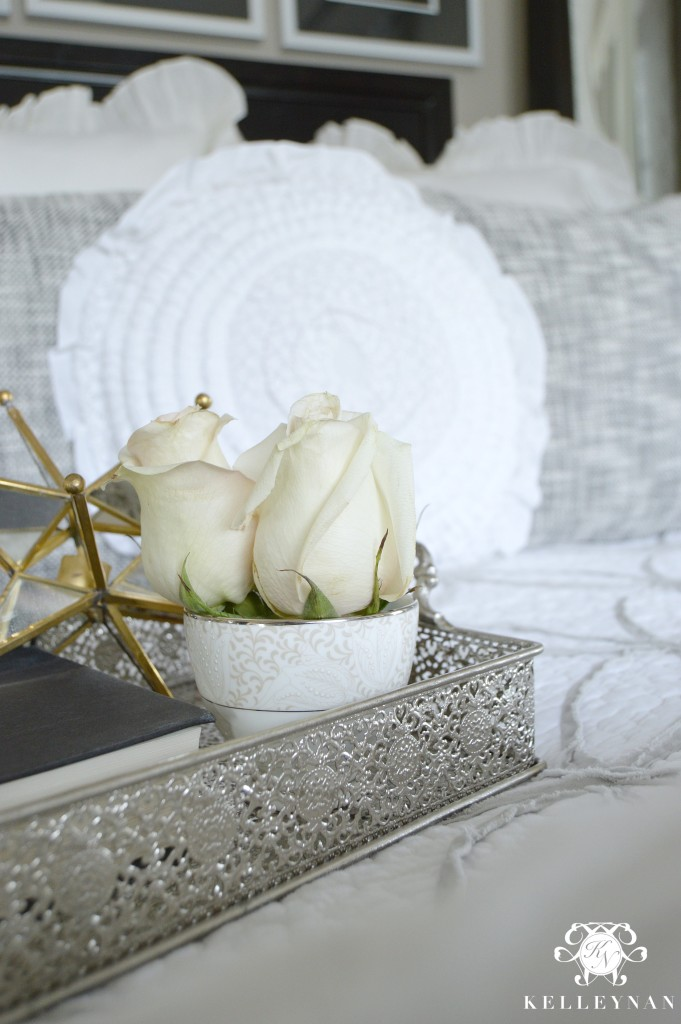 Decorative tray on bed