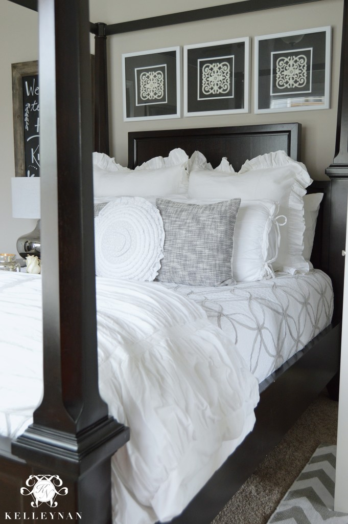 Black canopy bed with white bedding