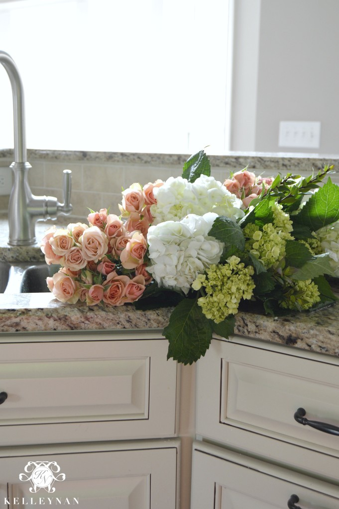 Roses and hydrangeas in a sink