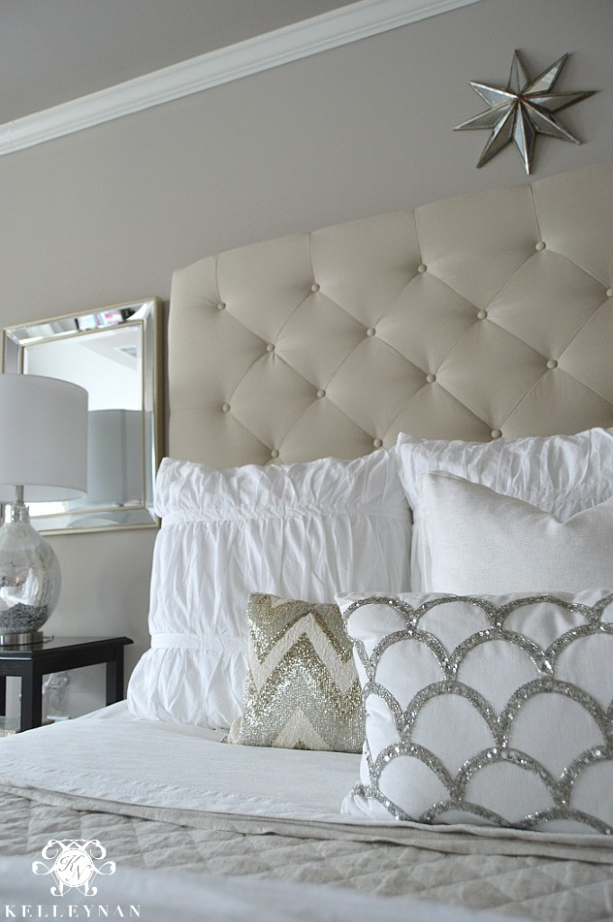 Neutral Beaded Pattern Pillows on tufted bed
