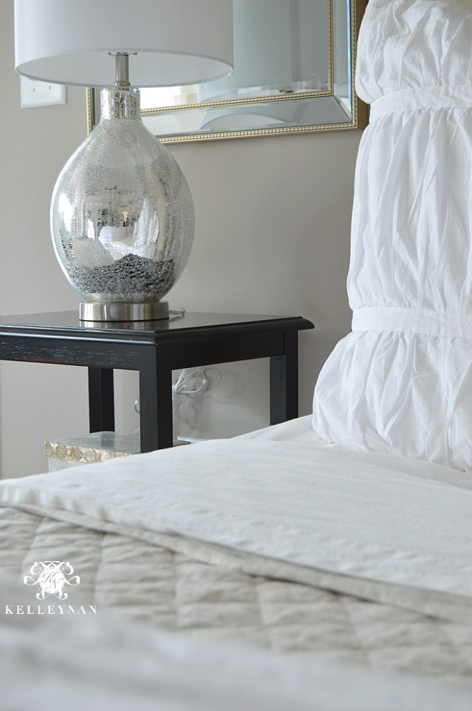 Mirrored lamp on bedside table