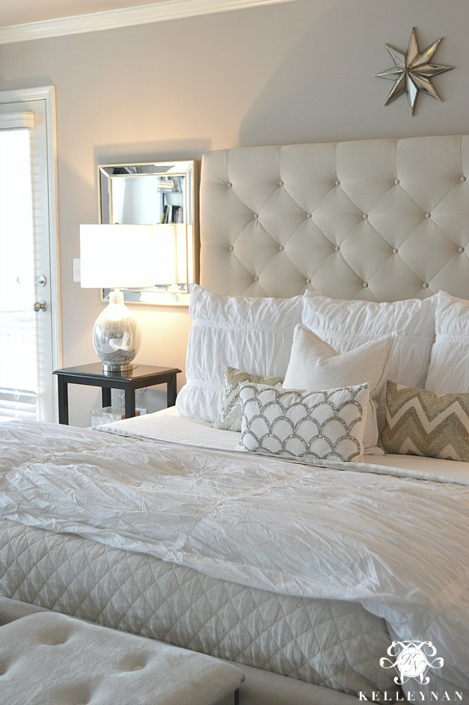 Pottery Barn Tall Lorraine Tufted Bed and white bedding