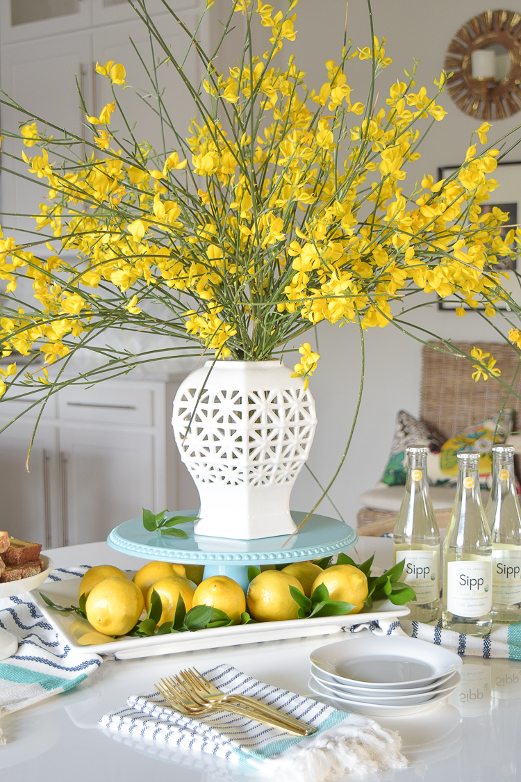 White-vase-spring-summer-dishes-aqua-cake-stand-forsythia-yellow-flower-bush-brunch-lemons-table-scape-center-piece_-14