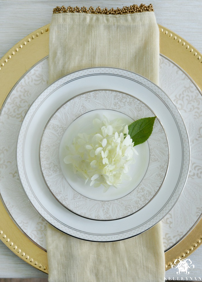 Elegant Neutral Table Setting with Hydrangea Bloom and Gold Beaded Napkin and Gold Charger