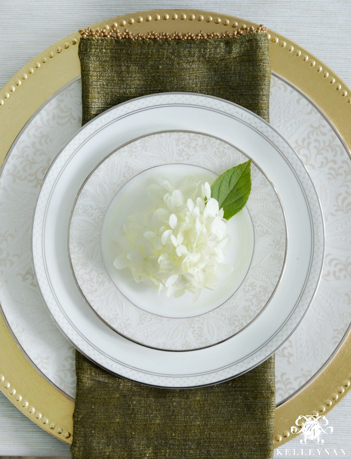 Green Beaded Napkin on Gold Charger at Place Setting