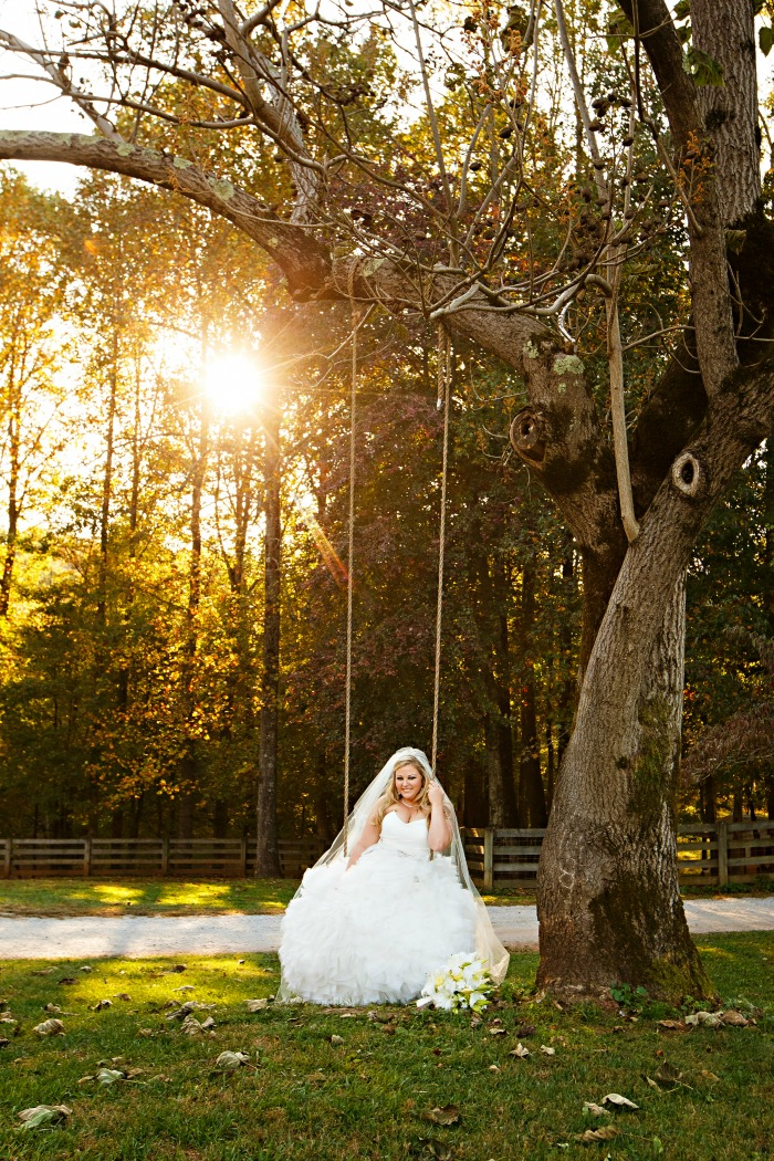 bridal-wedding-portrait-on-tree-swing-with-sunset