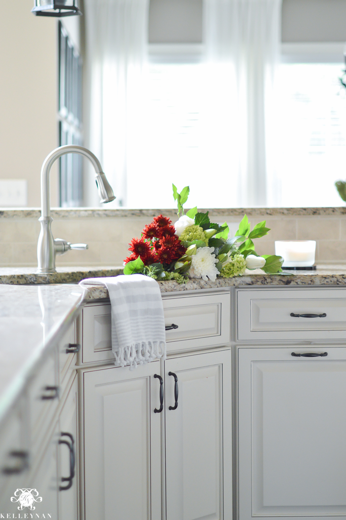 flowers-in-the-sink-with-white-kitchen