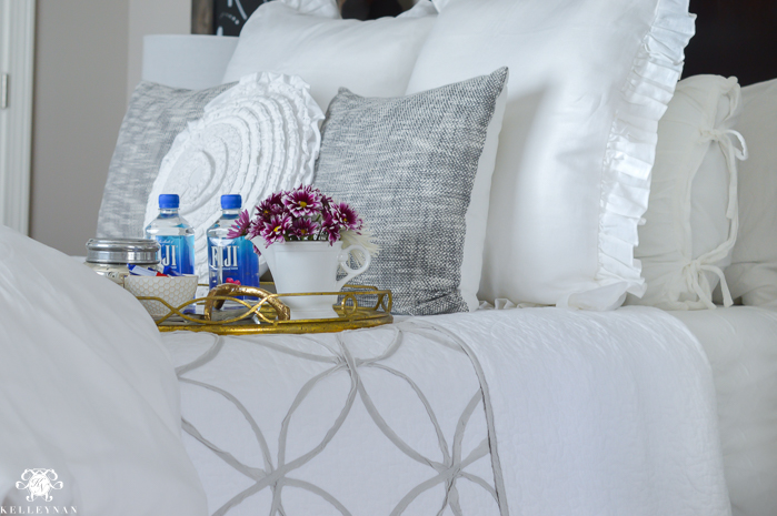 guest-bedroom-tray-on-white-bed-with-water