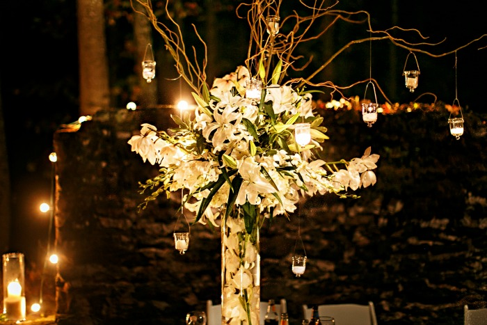 large-wedding-reception-centerpieces-with-white-flowers-and-hanging-candles