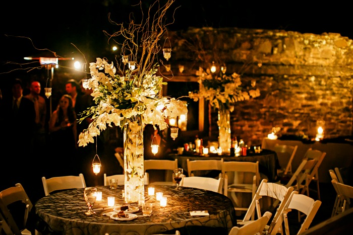 outdoor-wedding-reception-with-huge-table-centerpieces-romantic-and-candle-lit