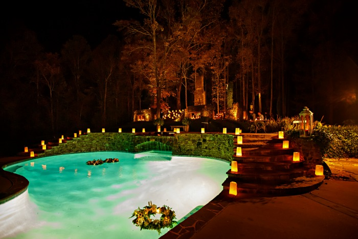 pool-with-floating-floral-wreaths-at-reception-wedding