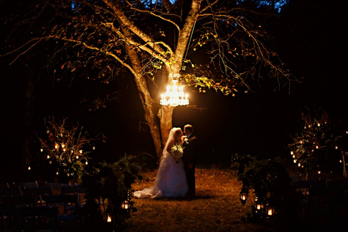 romantic-outdoor-wedding-at-night-with-chandelier-hanging-from-tree
