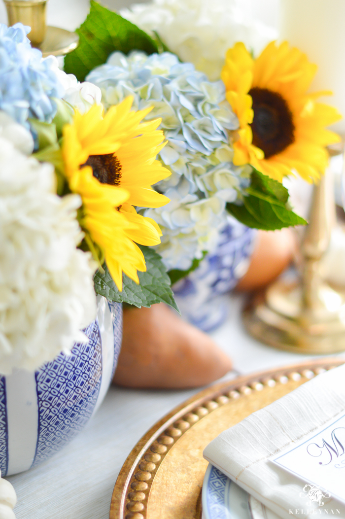 blue-and-white-thanksgiving-table-idea-with-sunflowers-and-hydrangeas-21-of-21