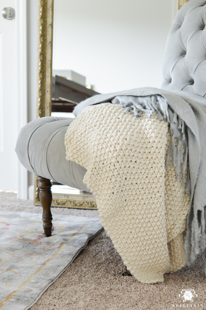 cozy-throws-on-tufted-slipper-chair-in-office