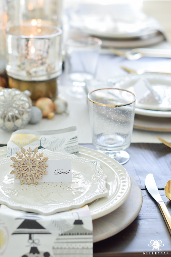 silver-and-gold-world-market-holiday-christmas-tablescape-ideas-with-snowflakes-and-hurricanes-with-candles-1-of-18