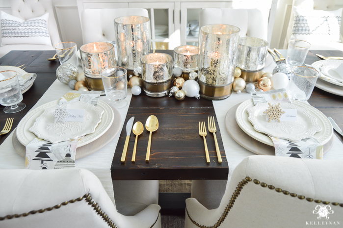 silver-and-gold-world-market-holiday-christmas-tablescape-ideas-with-snowflakes-and-hurricanes-with-candles-10-of-18