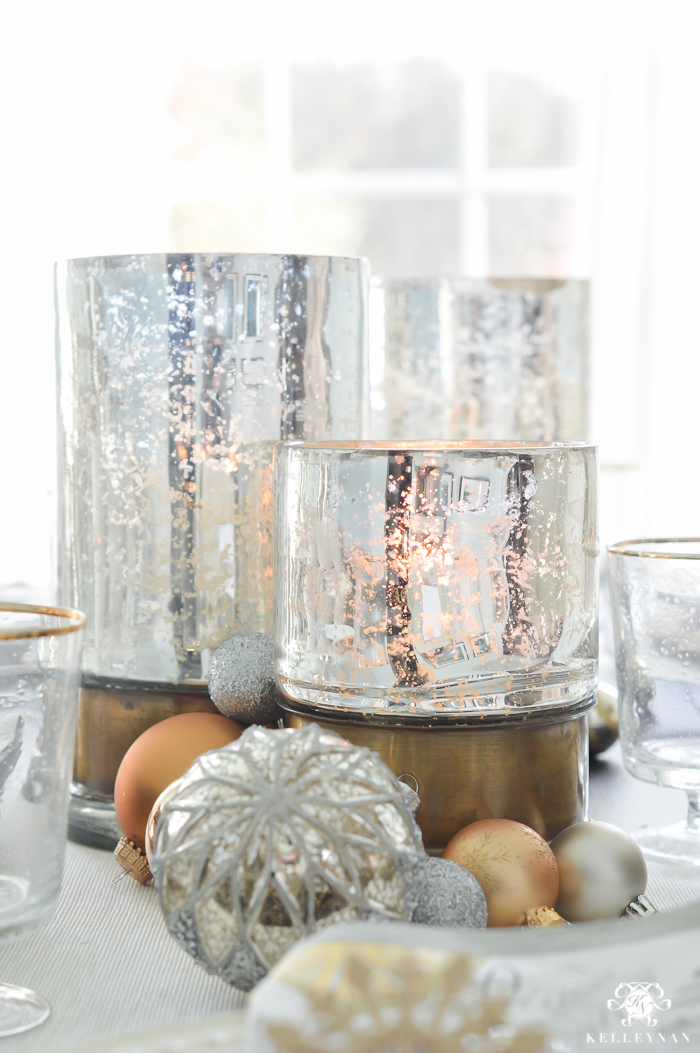 silver-and-gold-world-market-holiday-christmas-tablescape-ideas-with-snowflakes-and-hurricanes-with-candles-12-of-18
