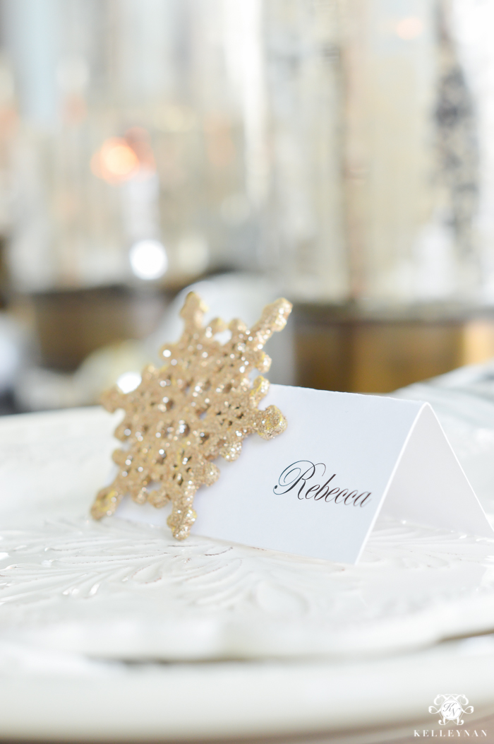 silver-and-gold-world-market-holiday-christmas-tablescape-ideas-with-snowflakes-and-hurricanes-with-candles-16-of-18