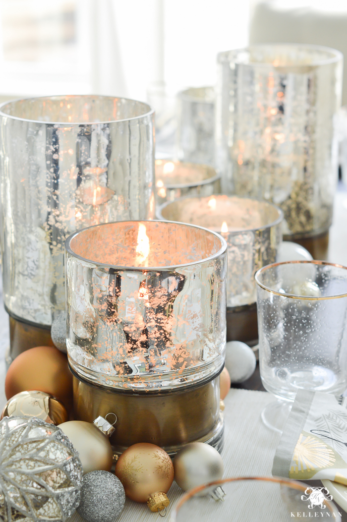 silver-and-gold-world-market-holiday-christmas-tablescape-ideas-with-snowflakes-and-hurricanes-with-candles-18-of-18