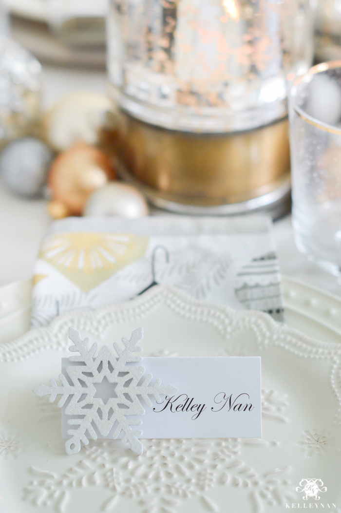silver-and-gold-world-market-holiday-christmas-tablescape-ideas-with-snowflakes-and-hurricanes-with-candles-2-of-18