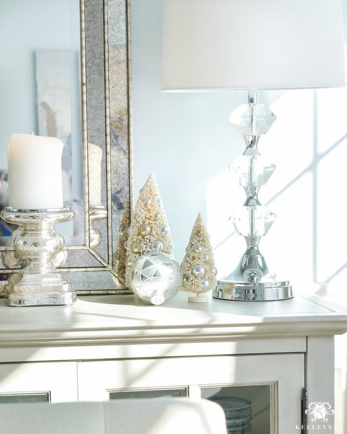 silver-and-gold-world-market-holiday-christmas-tablescape-ideas-with-snowflakes-and-hurricanes-with-candles-3-of-18