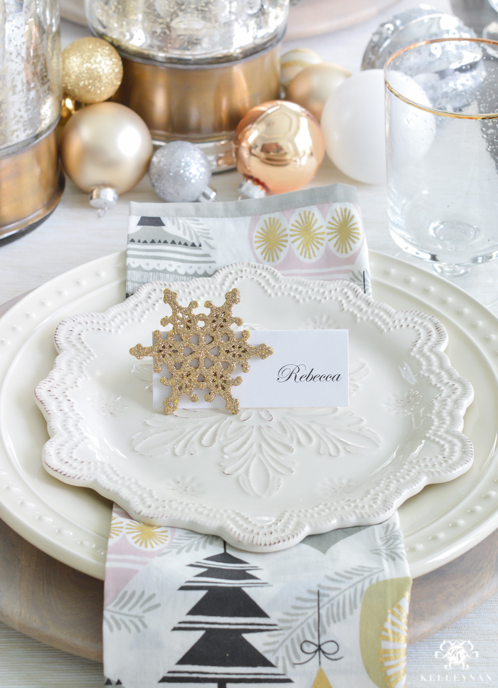 silver-and-gold-world-market-holiday-christmas-tablescape-ideas-with-snowflakes-and-hurricanes-with-candles-6-of-18