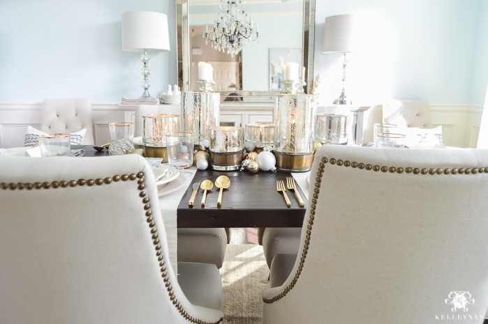 silver-and-gold-world-market-holiday-christmas-tablescape-ideas-with-snowflakes-and-hurricanes-with-candles-8-of-18