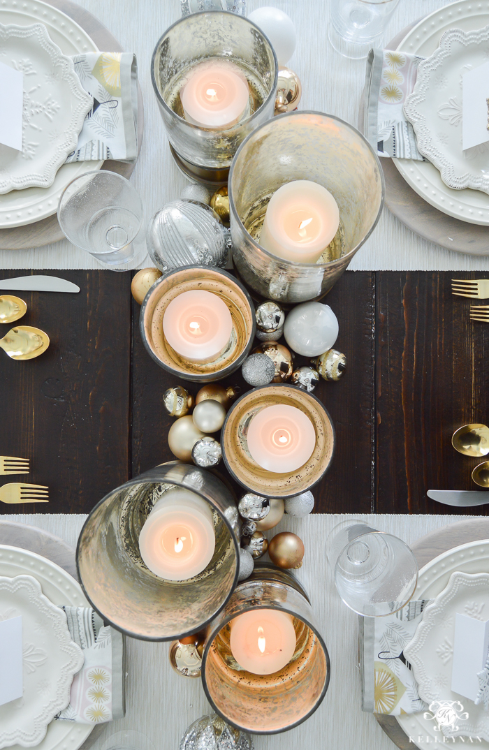 silver-and-gold-world-market-holiday-christmas-tablescape-ideas-with-snowflakes-and-hurricanes-with-candles-9-of-18