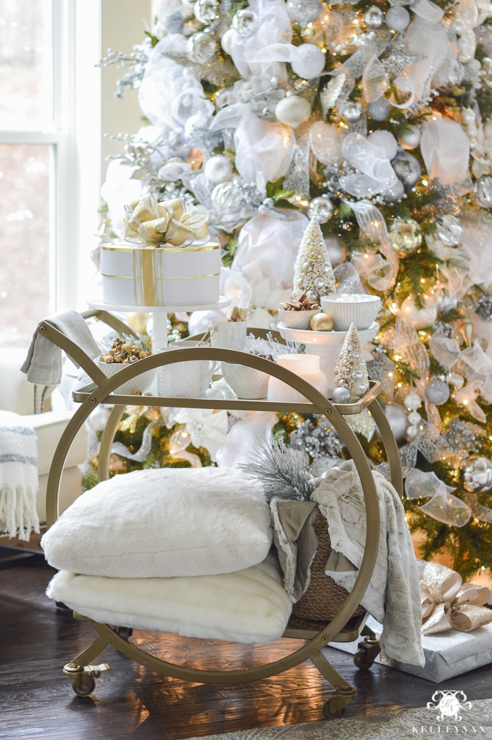 bar-cart-in-front-of-christmas-tree-with-cozy-pillows