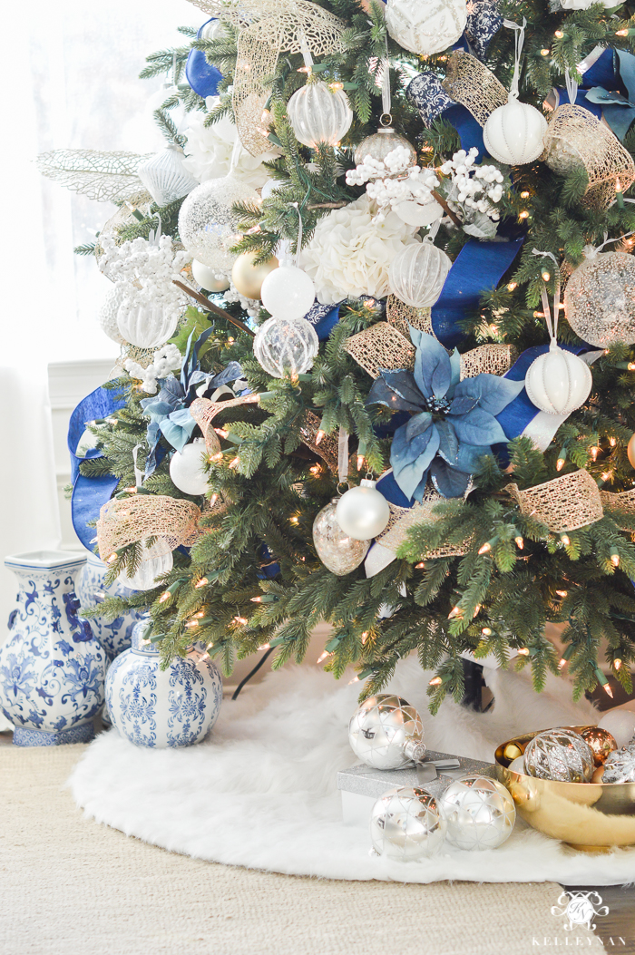 blue white and gold christmas tree with fur