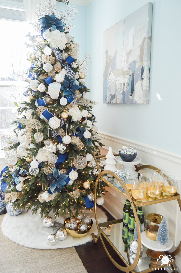 blue and white christmas tree with bar cart