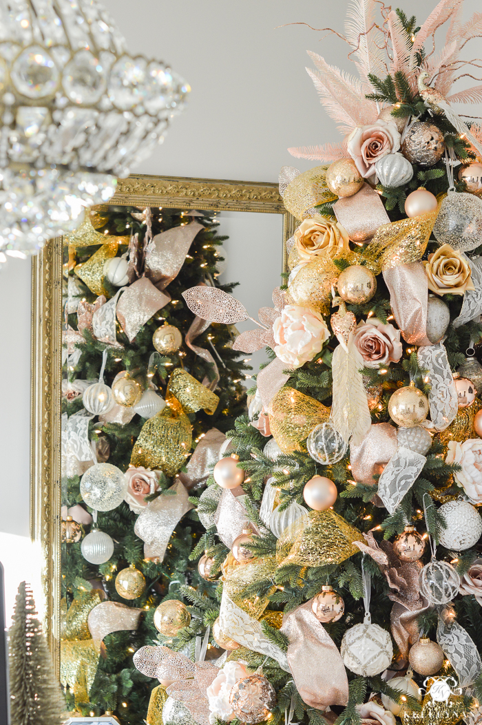 christmas-tree-in-front-of-gold-mirror-and-chandelier