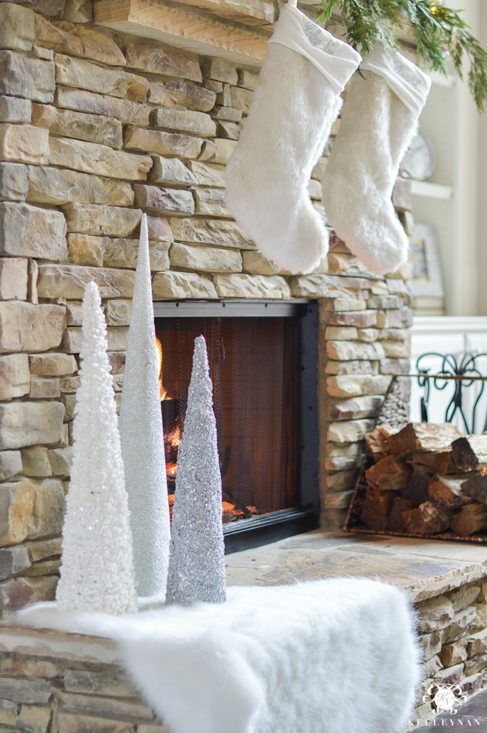 christmas-trees-on-fireplace-with-fur-stockings