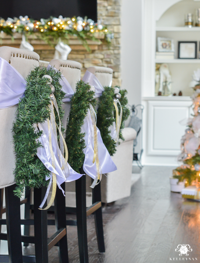 christmas-wreaths-hanging-on-back-on-linen-lydia-bar-stools
