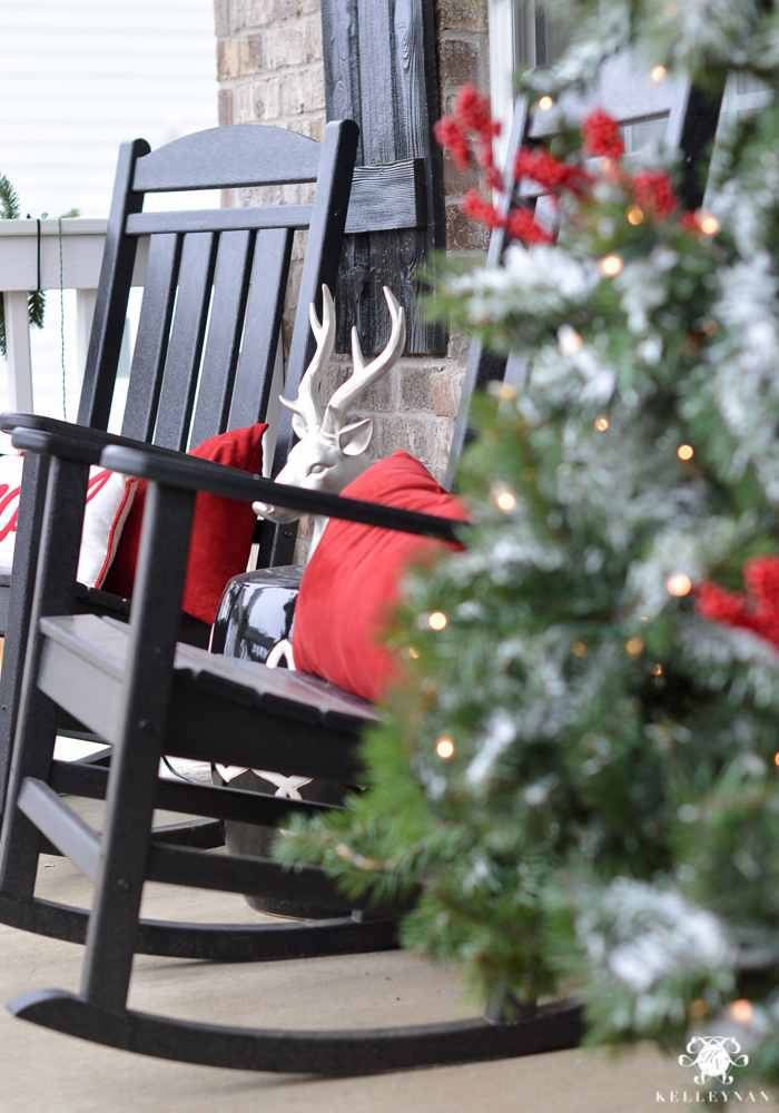 classic-black-rocking-chairs-on-christmas-front-porch-with-christmas-tree