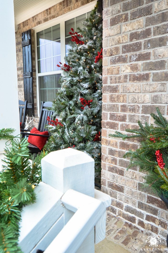 flocked-christmas-tree-on-front-porch