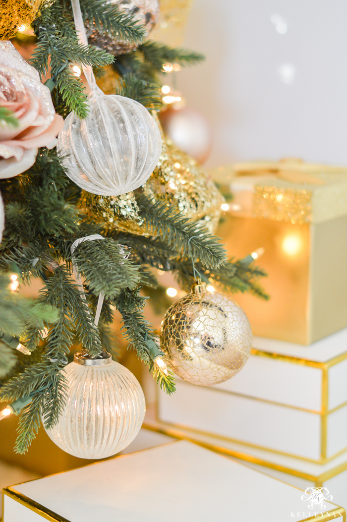 gold-and-white-wrapped-boxes-under-office-christmas-tree
