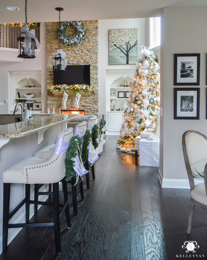 two-story-christmas-great-room-with-stacked-stone-fireplace-and-big-christmas-tree-and-linen-lydia-bar-stools
