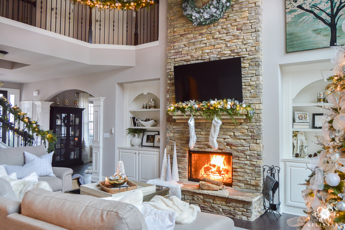 two-story-christmas-great-room-with-stacked-stone-fireplace-and-big-christmas-tree