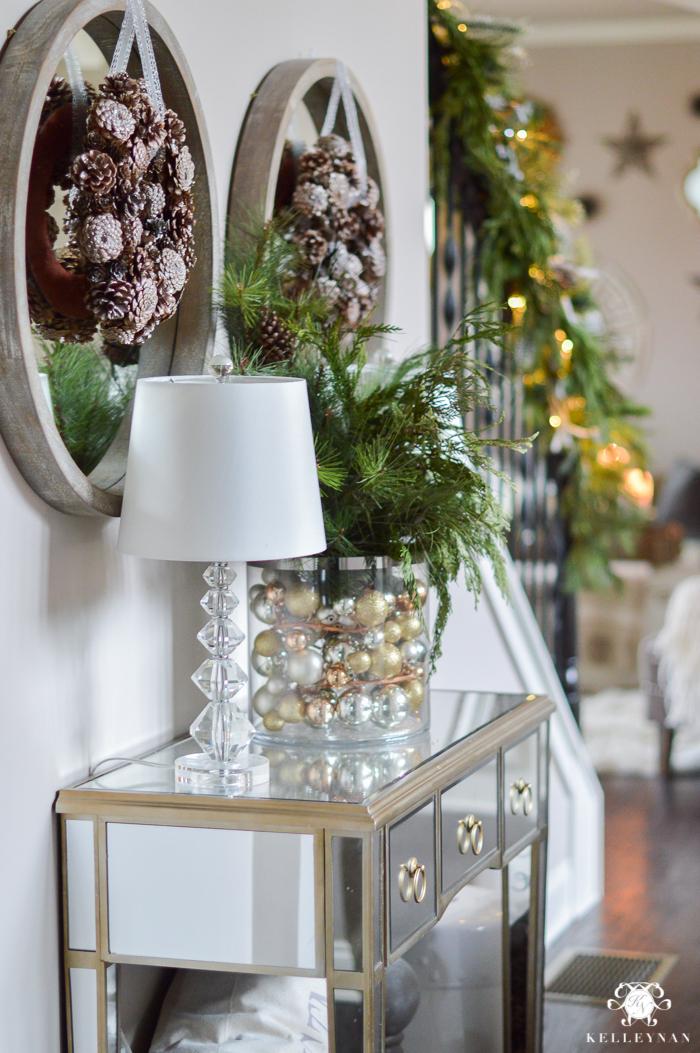 wreaths-handing-on-mirrors-with-cedar-garland