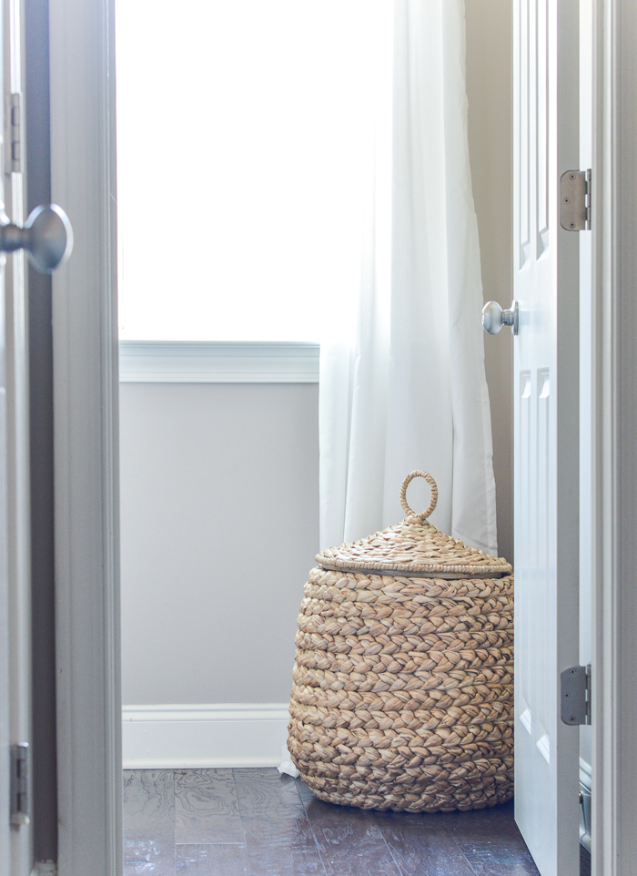 Pottery Barn Tulip basket in powder room with toilet paper