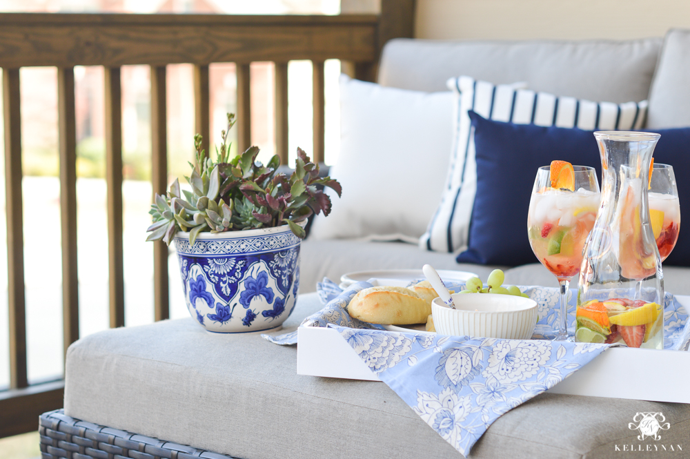 Blue and White outdoor decor on sectional
