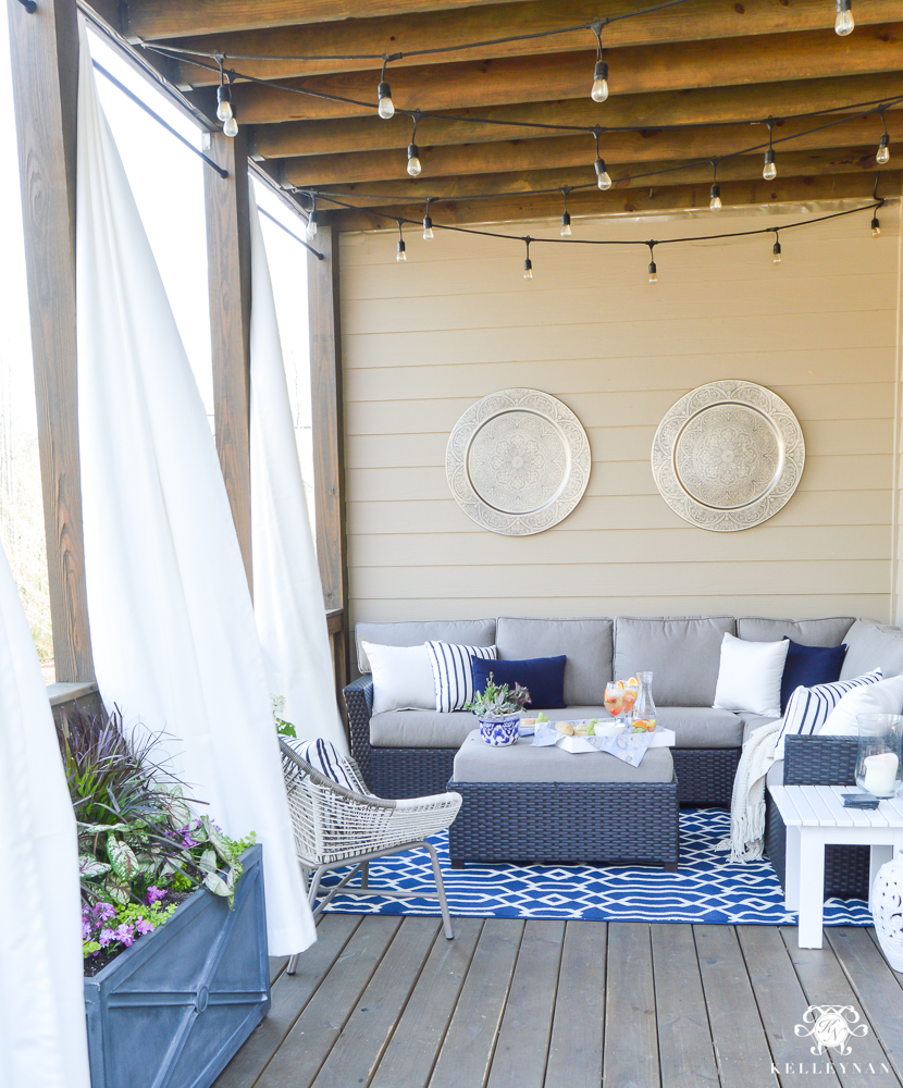 Outdoor curtains on back porch - bue and white outdoor living